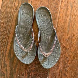 Black Crocs flip flops
